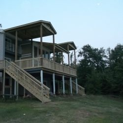 A large deck off of second story with two sets of stairs - Ready Decks