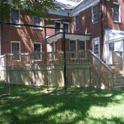 A brick house with large deck and stairs - Ready Decks