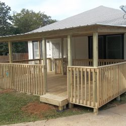 A large covered porch in the front of a house - Ready Decks