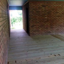 A brick building with wooden deck - Ready Decks
