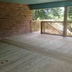 A large wooden deck and landing to stairs going down - Ready Decks