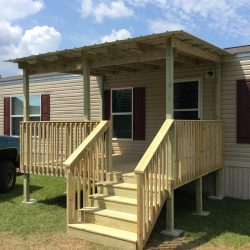 A raised covered porch in front of a mobile house - Ready Decks