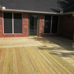 A wall-to-wall deck off a brick house - Ready Decks