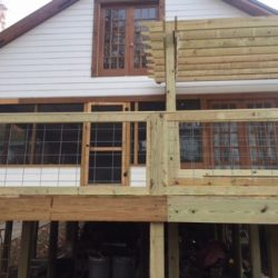 A second story deck behind a house with pergola - Ready Decks