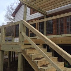 A second story deck with steps and railing - Ready Decks
