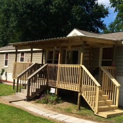 Front of a mobile home with a porch with two steps - Ready Decks