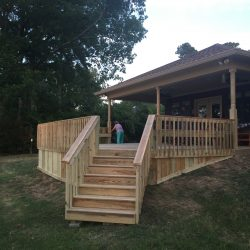 A new deck with railing, wood skirting, and stairs - Ready Decks