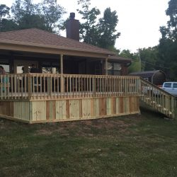 Wooden deck with wood skirting behind a house - Ready Decks