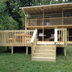 A multi-level deck with stairs behind a house - Ready Decks