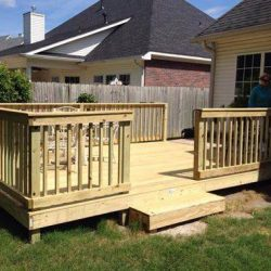 A backyard deck with railing and step - Ready Decks