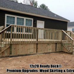 A home with a 12x20 deck with wood skirting and extra steps - Ready Decks