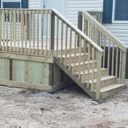 A mobile home with deck that has wood skirting and stairs - Ready Decks