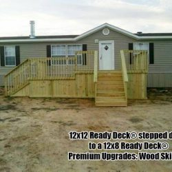 A mobile home with 12x8 deck and premium wood skirting - Ready Decks