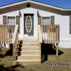 The front of a house with a 10x12 deck and stairs - Ready Decks