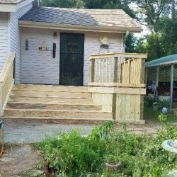 A house with deck with wide stairs and corner wood skirting - Ready Decks