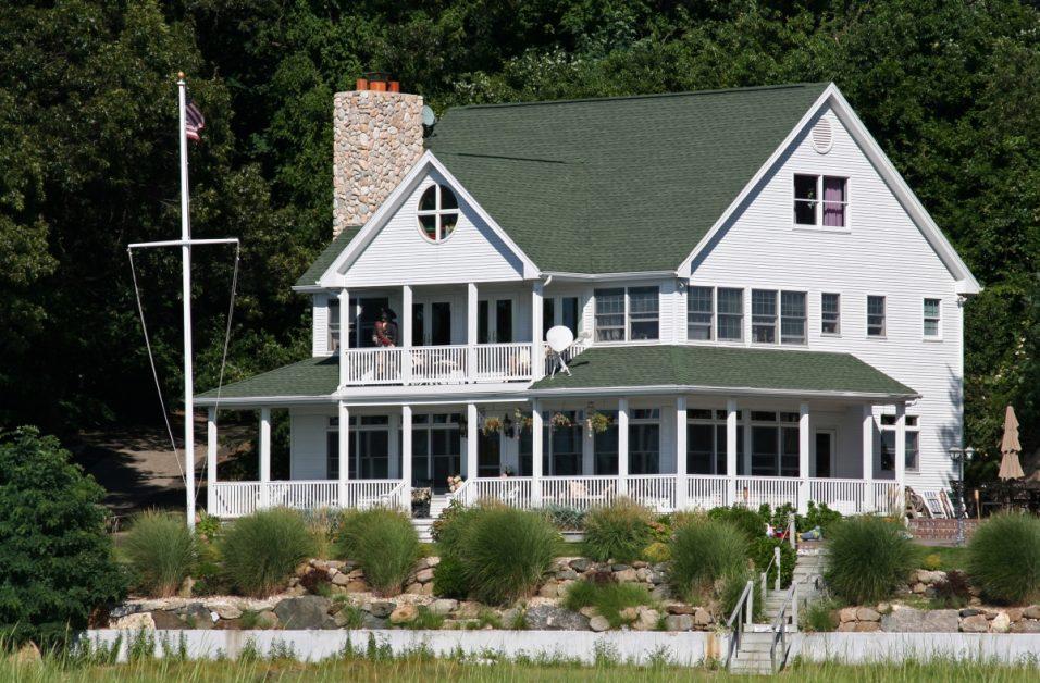 Green Asphalt Shingles on White Home