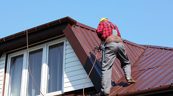 Roofer Installing New Metal Roof