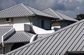 Metal Roofing on White Stucco Homes