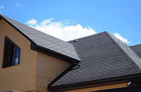 Dark Grey Shingles on Brick Home