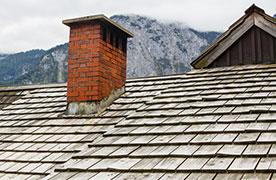 Wood Shake Roof With Brick Chimney