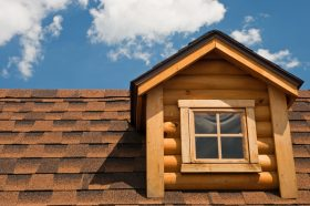 Brown Asphalt Shingles on a Wood Cabin