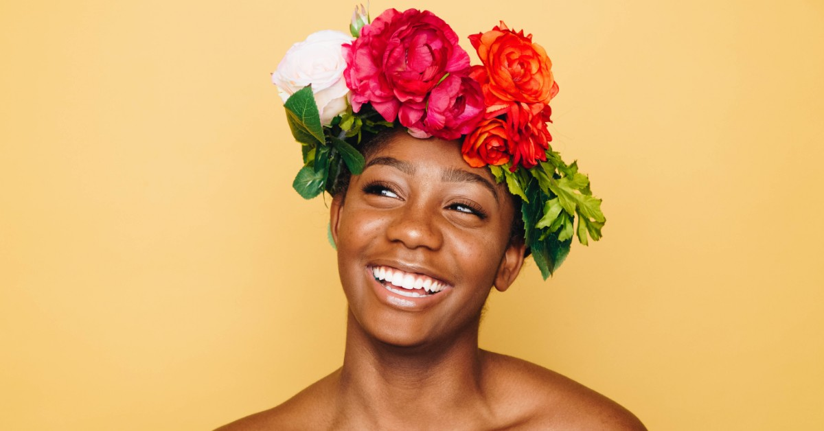 Beautiful smiling woman wearing a flower crown.