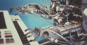 Machine robot playing the piano.