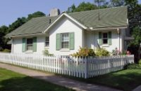 Image of traditional looking house with picket fencing