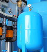Image of large blue tank with piping fixtures