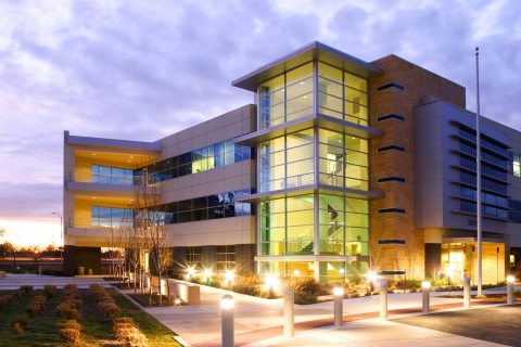 Exterior image of large commercial building and outdoor lighting