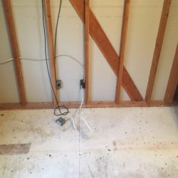 water damage restoration on floor and wood studs