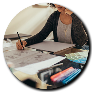 Woman working at a desk designing