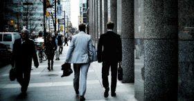 men in suits walking down the street