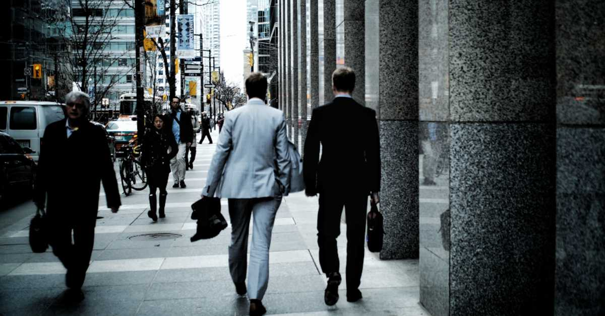 men in suits walking down the street