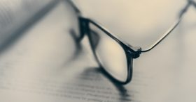 Photo of glasses on paper by James Sutton on Unsplash