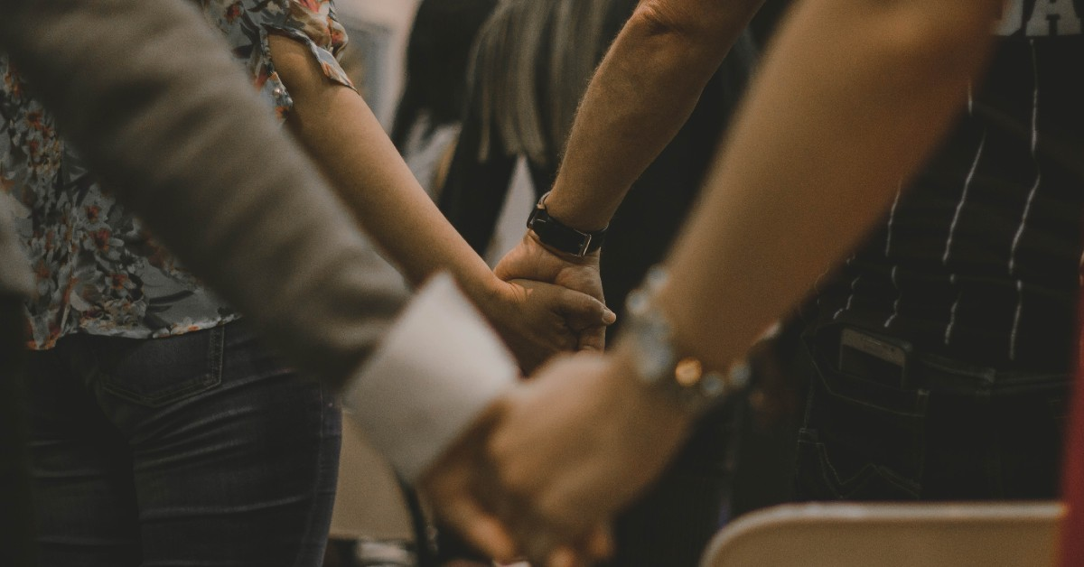 Photo of people holding hands by Pedro Lima on Unsplash