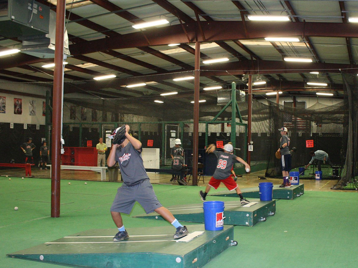 An image of a baseball player using Rip City Training facility pitching mounds.