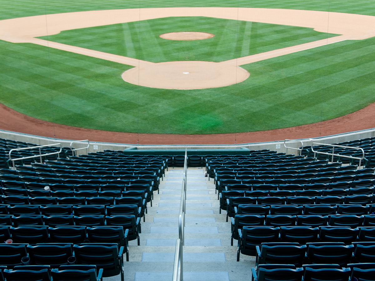 A image of home plate seating and a baseball field within an MLB stadium.