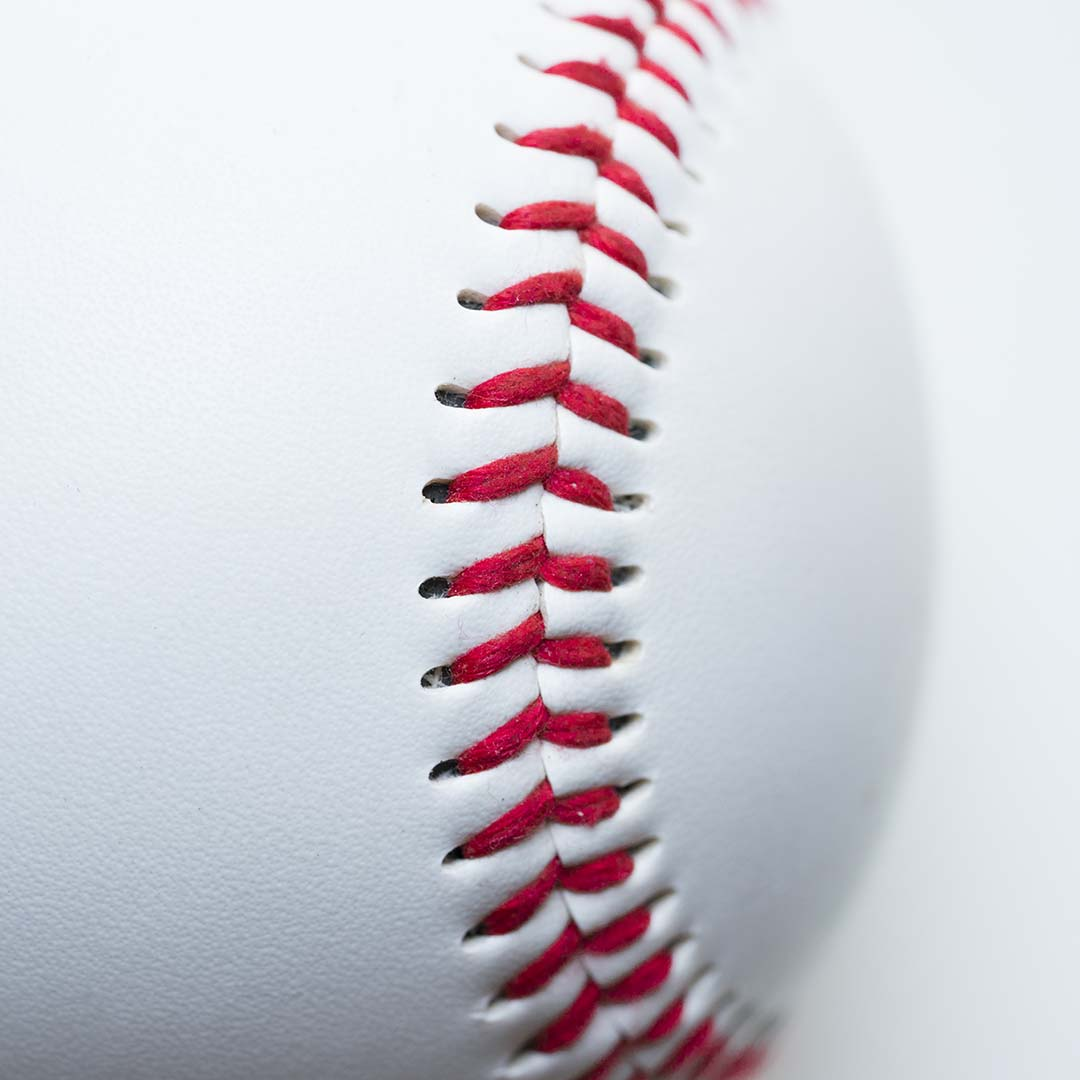 An up close view of a clean, white baseball.