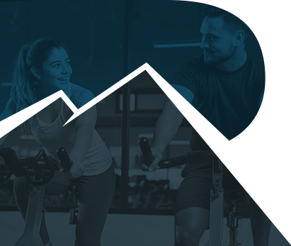 Photo of a couple on stationary bikes