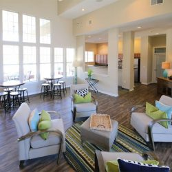 The bright, sunny and comfortable common room at the Riverwalk Apartments.