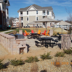 A pretty public patio for the Riverwalk Apartments