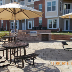 A look at at the outdoor kitchen and and outdoor tables at the Riverwalk Apartments.