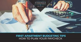 "A person points to a bar graph with a pen with the words ""First apartment budgeting tips how to plan your paycheck"""