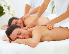 couple receiving massages at a spa