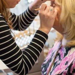 A client getting her makeup done - Riverspointe Spa