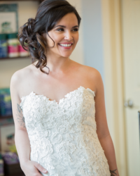A bride with curly hair over her shoulders - Riverspointe Spa