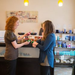 A client choosing products at our spa - Riverspointe Spa