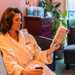 A client reading and relaxing at our spa - Riverspointe Spa