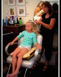 A flowergirl getting her hair done at our spa - Riverspointe Spa